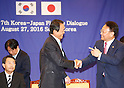 Taro Aso and Yoo Il-ho, Aug 27, 2016 : Japanese Finance Minister Taro Aso (C) and his South Korean counterpart Yoo Il-ho (R) chat during a photo session after their talks at an office of the South Korean Government Complex Seoul in Seoul, South Korea. The bilateral meeting was the seventh talks between Japan and South Korea since 2006. The finance ministers from Japan and South Korea agreed on Saturday to resume a currency swap deal to strengthen bilateral economic cooperation, local media reported. (Photo by Lee Jae-Won/AFLO) (SOUTH KOREA)