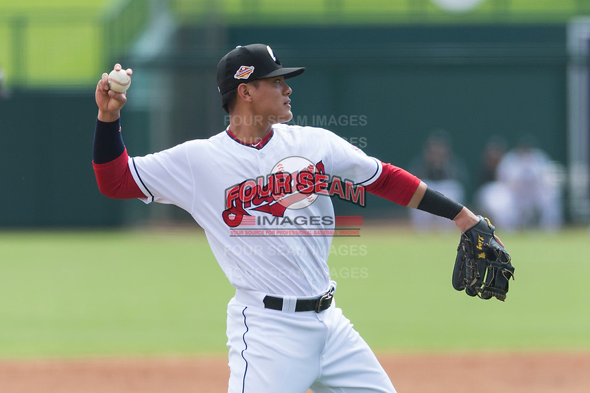 Glendale Desert Dogs third baseman Yu Chang (9), of the Cleveland Indians organization, throws to first base during an Arizona Fall League game against the Scottsdale Scorpions at Camelback Ranch on October 16, 2018 in Glendale, Arizona. Scottsdale defeated Glendale 6-1. (Zachary Lucy/Four Seam Images)
