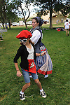 Jill Beglin, left, dances with Zenbat Gara dancer Lisa Corcostegui during the 13th annual  St. Teresa of Avial Basque Festival Sunday Sept. 19, 2010 at Fuji Park in Carson City, Nev..Photo by Lisa J. Tolda/Lisajphotos@gmail.com