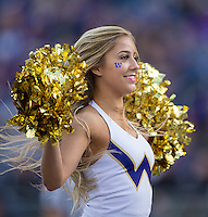 A Husky cheerleader entertains the crowd.