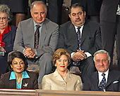 In this file photo from January 20, 2004, first lady Laura Bush sits with invited guests from the Iraqi Governing Council for her husband, United States President George W. Bush's 2004 State of the Union Address to a Joint Session of the United States Congress at the Capitol in Washington, D.C. on January 20, 2004.  Left to right in the top row: Doctor Ahmed Chalabi, Iraqi Governing Council; and Hoshyar Zebari, Iraqi Interim Foreign Minister.  Left to right on the bottom row: Ms. Rend al-Rahim, Iraqi Senior Diplomatic Representative; first lady Laura Bush; and Doctor Adnan Pachachi, President, Iraqi Governing Council.  Iraqi state media reported Chalabi passed away from a heart attack on November 3, 2015.  He was in his early 70s.<br /> Credit: Ron Sachs / CNP