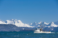 Commercial fishing purse seine boat passes through Kachemak Bay, Kenai Mountains, Kenai Peninsula, Alaska.