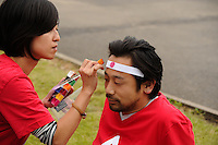 01.08.2012 Coventry, England. Japanese fans attending the Olympic Football Men's Preliminary game between Japan and Honduras from the City of Coventry Stadium Man gets his face painted