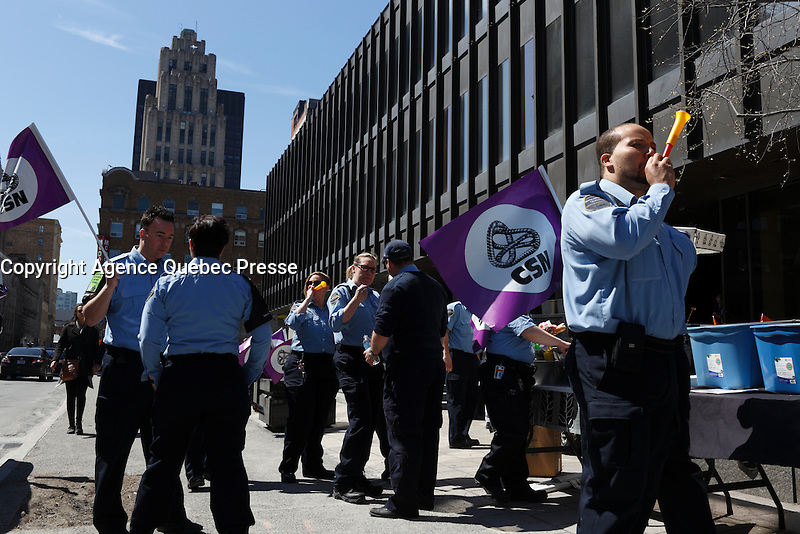 Quebec's Correctional Service Agents protest in front of Montreal court house, Thursday April 21, 2016.<br /> <br /> They are negociating work condition with the Government<br /> <br /> Photo : Pierre Roussel - Agence Quebec Presse<br /> <br /> <br /> <br /> <br /> <br /> <br /> <br /> <br /> .