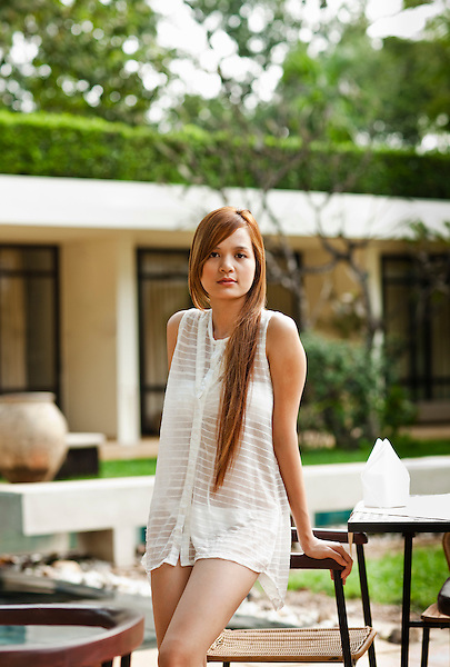Woman by pool, FCC Angkor, Siem Reap, Cambodia. Built on the grounds of the former French governor's mansion, the renovated hotel now features 31 rooms and a saltwater swimming pool.