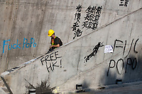 Words of graffitis seen around the campus. <br /> Siege at Polytechnic University.<br /> Police surround the university campus after pro-democratic protesters blocked the cross-harbour tunnel and the major road outside the campus.<br /> Hong Kong protest continuous on its sixth months. A citywide strike called for started on Monday 11 November, 2019 which brought parts of Hong Kong to halt as MTR stations closed and multiple roadblocks were erected. Hong Kong, 17.11.2019