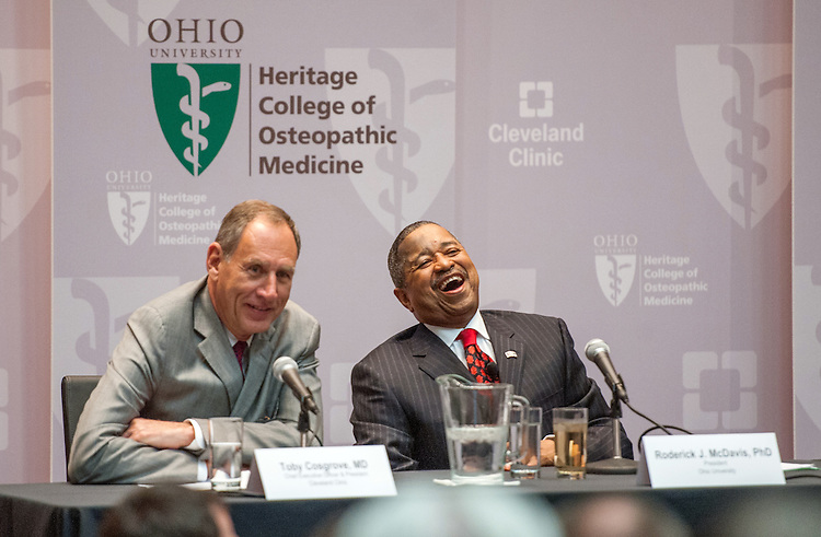 Ohio University President Dr. Roderick McDavis (Right) and Cleveland Clinic CEO Dr. Toby Cosgrove (Left) react to a question at a press conference at Southpointe Hospital.