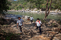 Jan. 26, 2012 - Yopal, Colombia. Children head home from school with their father. © Nicolas Axerlod / Ruom