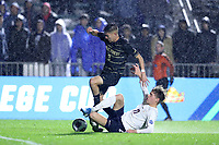 CARY, NC - DECEMBER 13: Andreas Ueland #17 of University of Virginia tackles the ball away from Kyle Holcomb #3 of Wake Forest University during a game between Wake Forest and Virginia at Sahlen's Stadium at WakeMed Soccer Park on December 13, 2019 in Cary, North Carolina.