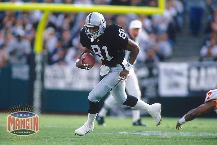 OAKLAND, CA - Tim Brown of the Oakland Raiders in action during a game at the Oakland Coliseum in Oakland, California in 1995. Photo by Brad Mangin