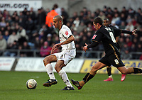 Pictured: Darren Pratley of Swansea City (L) followed by Michael Doyle of Coventry City (R)<br /> Re: Coca Cola Championship, Swansea City FC v Coventry City at the Liberty Stadium. Swansea, south Wales, Friday 26 December 2008.<br /> Picture by D Legakis Photography / Athena Picture Agency, Swansea 07815441513