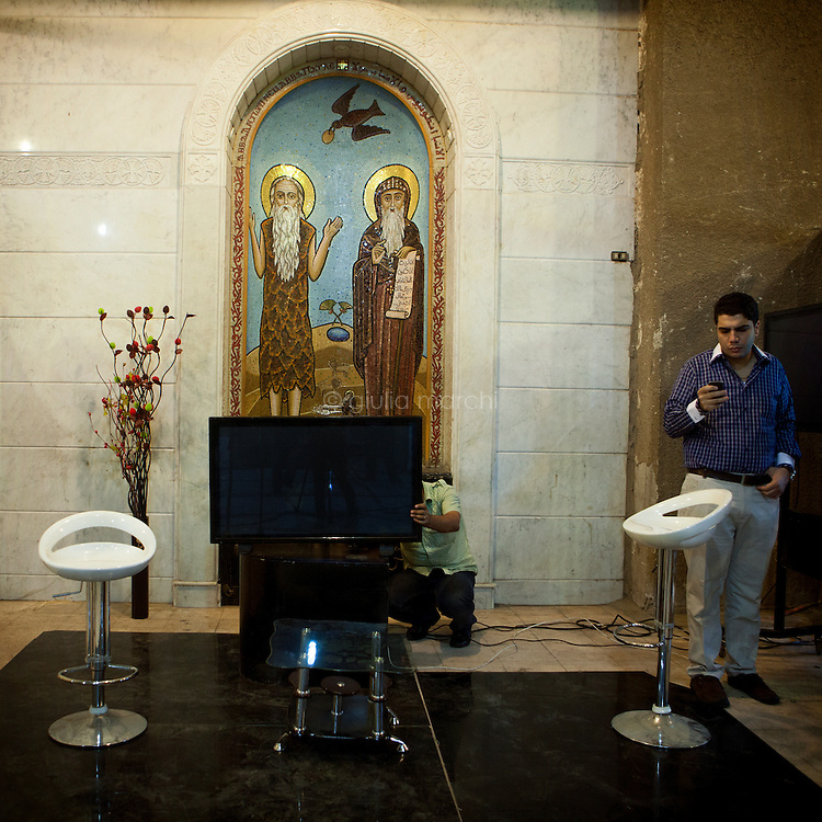 Egypt / Cairo / 4.11.2012 / Journalists in St Mark Cathedral in Abbasseya get ready to cover the Papal election ceremony. © Giulia Marchi