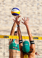 Brazil's Talita Antunes in action against Germany's Kira Walkenhorst, right, at the Beach Volleyball World Tour Grand Slam, Foro Italico, Rome, 21 June 2013.<br /> UPDATE IMAGES PRESS/Isabella Bonotto