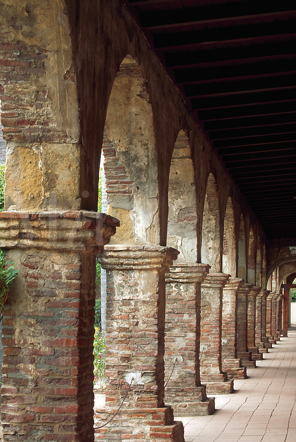 A colonnade of Mission style arches illustrates this tradional architectural technique. San Juan Capistrano, California.
