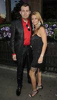 Paul Rudd & guest.attended the Kensington Club new boutique nightclub launch party, The Kensington Club, High Street Kensington, London, England,.20th July 2012..full length black suit red shirt dress tassels fringed .CAP/CAN.©Can Nguyen/Capital Pictures.