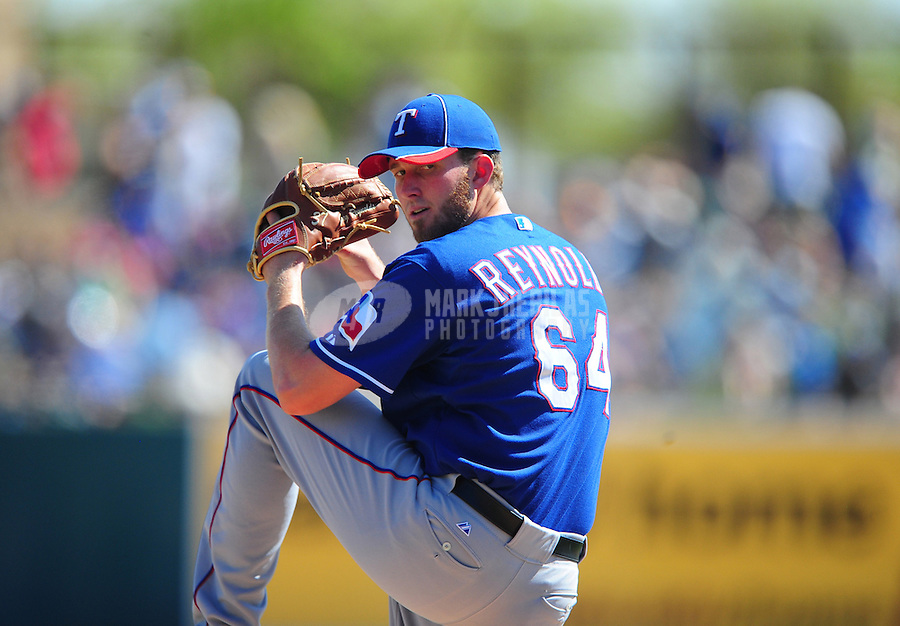 Mar. 16, 2012; Phoenix, AZ, USA; Texas Rangers pitcher Greg Reynolds throws in the third inning against the Los Angeles Dodgers at The Ballpark at Camelback Ranch. Mandatory Credit: Mark J. Rebilas-