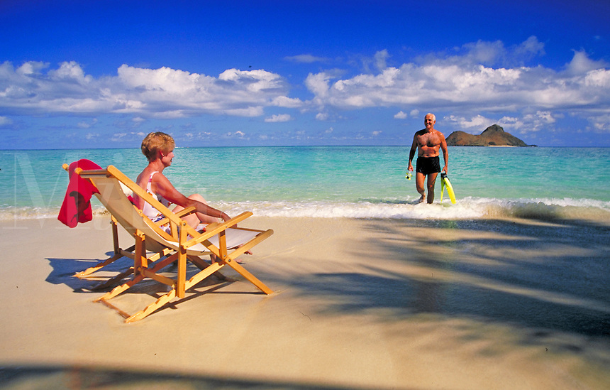 Senior retired couple enjoy the Hawaiian beach.