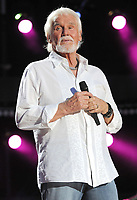 """20 March 2020 - Kenny Rogers, whose legendary music career spanned nearly six decades, has died at the age of 81. Rogers was inducted to the Country Music Hall of Fame in 2013."""" He had 24 No. 1 hits and through his career more than 50 million albums sold in the US alone. He was a six-time Country Music Awards winner and three-time Grammy Award winner. Some of his hits included """"Lady,"""" """"Lucille,"""" """"We've Got Tonight,"""" """"Islands In The Stream,"""" and """"Through the Years."""" His 1978 song """"The Gambler"""" inspired multiple TV movies, with Rogers as the main character. File Photo: 09 June 2012 - Nashville, Tennessee - Kenny Rogers. 2012 CMA Music Festival Nightly Concert held at LP Field. Photo Credit: Laura Farr/AdMedia"""