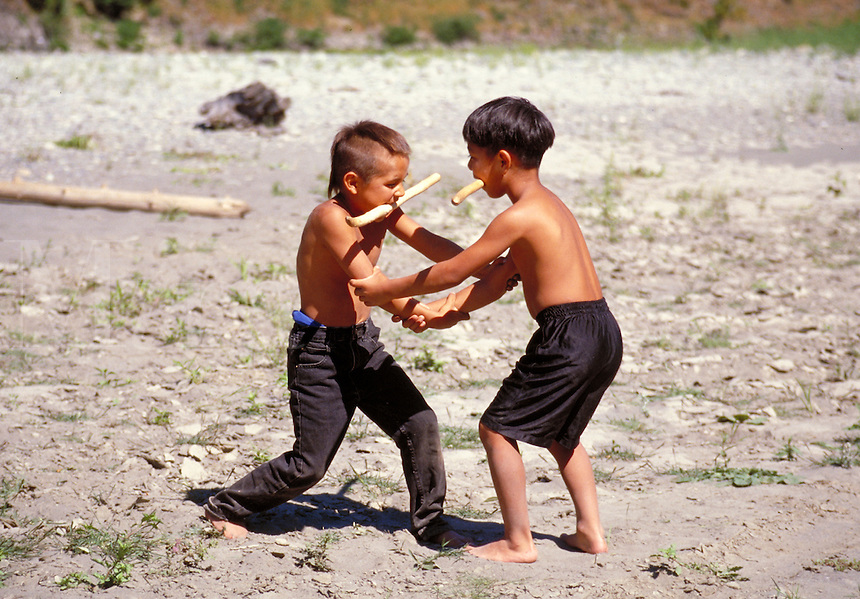 Yurok boys playing stickball on the beach at the Klamath river,  California