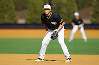 First baseman Austin Harclerode #25 of the Towson Tigers on defense against the Minnesota Golden Gophers at Gene Hooks Field on February 26, 2011 in Winston-Salem, North Carolina.  The Gophers defeated the Tigers 6-4.  Photo by Brian Westerholt / Sports On Film