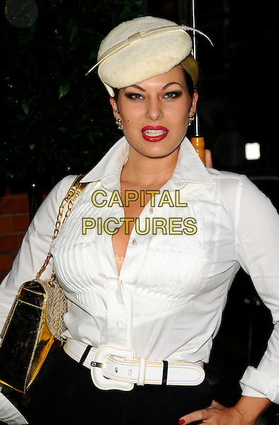 IMMODESTY BLAIZE.The Quintessentially Summer Arts Party, Phillips de Pury & co. building, Howick Place, London, England..July 9th, 2008.half length white cream hat blouse shirt hand on hip gold bag purse feather red lipstick belt .CAP/CAN.©Can Nguyen/Capital Pictures.