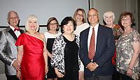 NWA Democrat-Gazette/CARIN SCHOPPMEYER Ron and Janet Moore (from left), Mamie Jones, Cecilia Tu, Katie Raines, Kent Jones, Jackee Smith and Linda Hardcastle visit at the BOST benefit.