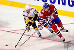 14 December 2009: Montreal Canadiens' defenseman Ryan O'Byrne battles Buffalo Sabres center Adam Mair for the puck during the first period at the Bell Centre in Montreal, Quebec, Canada. The Sabres defeated the Canadiens 4-3. Mandatory Credit: Ed Wolfstein Photo