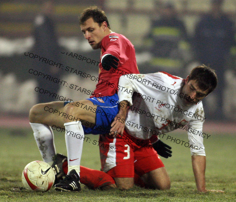 Milan Jovanovic of Serbia fights for the ball with Gregorz Bronowicki of Poland during UEFA EURO 2008 qualifying round match in Belgrade 21.11.2007. (credit image © photo: Pedja Milosavljevic / starsportphoto.com)