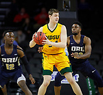 SIOUX FALLS, SD - MARCH 8: Rocky Kreuser #34 of the North Dakota State Bison looks to pass the ball while being guarded by Emmanuel Nzekwesi #23 of the Oral Roberts Golden Eagles at the 2020 Summit League Basketball Championship in Sioux Falls, SD. (Photo by Richard Carlson/Inertia)