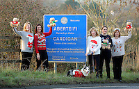 Pictured L-R: Local residents wearing Christmas jumpers Rhian Blackford, Linda Adams-Lewis, Christine Newman with her Cardigan Corgi dog, Ruth Martin and Donna Bentley by the Cardigan town sign<br /> Re: The town of Cardigan in west Wales will be temporarily renamed Jumper tomorrow (Thursday).