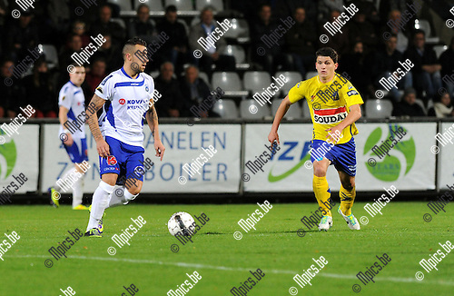 2013-11-02 / Voetbal / seizoen 2013-2014 / Westerlo - KSK Heist / Yannick Rymnants (l. Heist) met Jarno Molenberghs<br /><br />Foto: Mpics.be