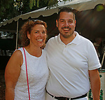 Washington, CT- 081217MK07 Lori Noto and Andrew Deacon gathered at the 20th annual Tea for Two Hundred at the home of Gael Hammer and Gary Goodwin in Washington Saturday afternoon. Event proceeds will benefit Gunn Historical Museum and Interfaith AIDS Ministry of Greater Danbury. Michael Kabelka / Republican-American