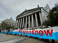 NEW YORK, USA - October 22: People take part in a protest against ExxonMobil before the start of its trial outside the New York State Supreme Court building on October 22, 2019 in New York, USA. the trial will establish whether Exxon Mobil, the country's largest fossil fuel company, lied to investors about the cost of carbon emissions to its business. (Photo by Eduardo MunozAlvarez/VIEWpress)