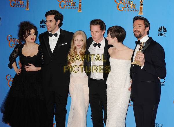 Cast of Les Miserables - Helena Bonham Carter, Sacha Baron Cohen, Amanda Seyfried, Eddie Redmayne, Anne Hathaway, Hugh Jackman.Press Room at the 70th Annual Golden Globe Awards held at the Beverly Hilton Hotel, Beverly Hills, California, USA..January 13th, 2013.globes half length dress award trophy winner winners trophies white lace strapless tuxedo black beard facial hair .CAP/GAG.©GAG/Capital Pictures