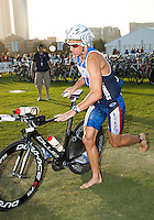 12 MAR 2011 - ABU DHABI, UAE - Dirk Bockel exits transition for the start of the bike during the Abu Dhabi International Triathlon .(PHOTO (C) NIGEL FARROW)