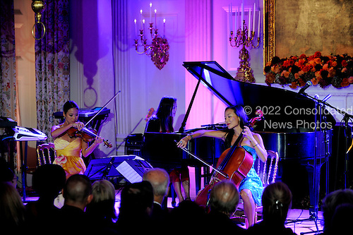 The Ahn Trio performs after a State Dinner hosted by United States President Barack Obama in honor of President Lee Myung-bak of South Korea in the State Dining Room of the White House in Washington, DC on Thursday, October 13, 2011. The State Visit comes only a day after Congress passed a free trade agreement with South Korea.  .Credit: Roger L. Wollenberg / Pool via CNP