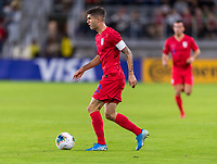 WASHINGTON, DC - OCTOBER 11: Christian Pulisic #10 of the United States dribbles during a game between Cuba and USMNT at Audi Field on October 11, 2019 in Washington, DC.