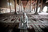 Kashmri muslim woman praying at the Jamia Masjid or grand mosque at midday in Srinagar as the main duty to observe the holy month of Ramadan. As the tradition is attended muslims has to fast from dawn to dusk, where they refrain from eating, drinking and smoking.