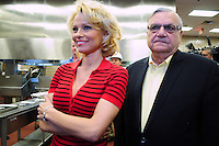 Phoenix, Arizona -- Actress Pamela Anderson with Maricopa County Sheriff Joe Arpaio at the Lower Buckeye County Jail facilities in Phoenix, Arizona. Anderson visited the jail in Phoenix, Arizona to promote all-vegetarian meals for inmates. Anderson visited the detention facilities as a spokesperson for People for the Ethical Treatment of Animals (PETA) . The actress was given a tour of the facilities by Maricopa County Sheriff Joe Arpaio.  Anderson was accompanied by PETA Senior Vice President Dan Mathews. Photo by Eduardo Barraza © 2015