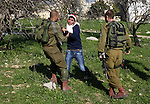 Israeli soldiers arrest a Palestinian protester during a demonstration at the Howara checkpoint near Nablus, West Bank, 01 January 2015. The checkpoint is one of four main checkpoints around Nablus but despite claims by the Israeli Government that the checkpoint would be removed to allow free movement between Nablus and Ramallah to date it remains in place. Photo by Nedal Eshtayah