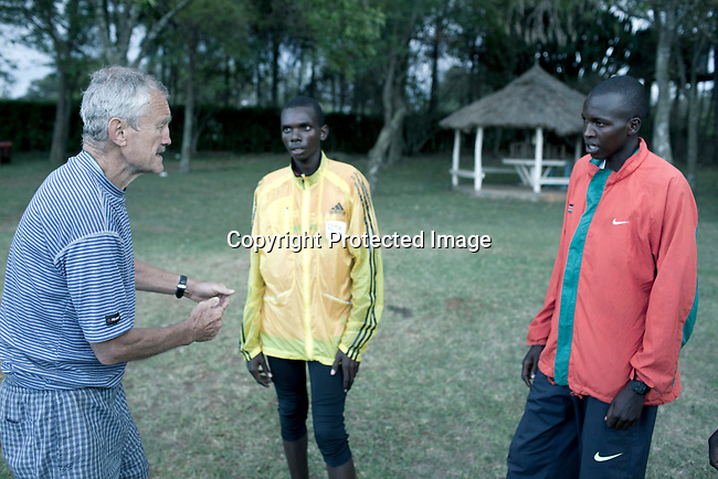 ELDORET, KENYA - MAY 19: Jonathan Kitum, age 16, and Eliud Kibet, age 18, and friends are during an afternoon training with German coach Gerd Himmelreich. They are promising long distance runners and they have already trained for an hour from 5.15 in the morning.(Photo by:  Per-Anders Pettersson)