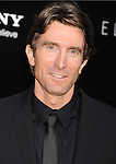 WESTWOOD, CA- AUGUST 07: Actor Sharlto Copley arrives at the Los Angeles premiere of 'Elysium' at Regency Village Theatre on August 7, 2013 in Westwood, California.