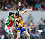 Conor Harrison of  Clooney-Quin in action against Jamie Shanahan of  Sixmilebridge during their senior county final at Cusack Park. Photograph by John Kelly.