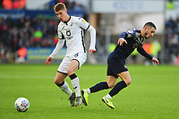 Jay Fulton of Swansea City battles with Conor Chaplin of Barnsley during the Sky Bet Championship match between Swansea City and Barnsley at the Liberty Stadium in Swansea, Wales, UK. Sunday 29 December 2019