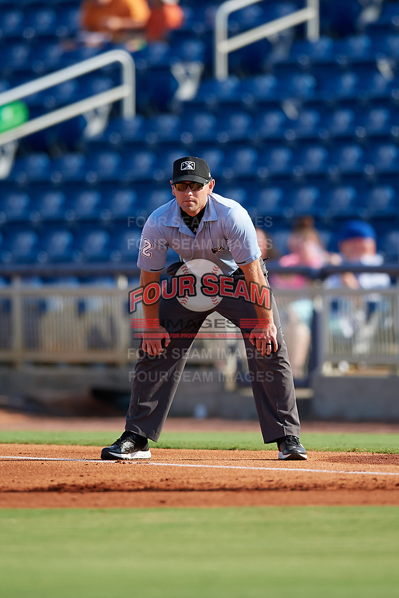 Umpire Brock Ballou during a Southern League game between the Mobile BayBears and Pensacola Blue Wahoos on July 25, 2019 at Blue Wahoos Stadium in Pensacola, Florida.  Pensacola defeated Mobile 2-1 in the first game of a doubleheader.  (Mike Janes/Four Seam Images)