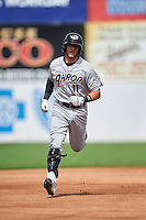 Akron RubberDucks left fielder Taylor Murphy (11) runs the bases after hitting a home run during the second game of a doubleheader against the Bowie Baysox on June 5, 2016 at Prince George's Stadium in Bowie, Maryland.  Bowie defeated Akron 12-7.  (Mike Janes/Four Seam Images)