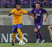 Calcio: amichevole Fiorentina vs Barcellona. Firenze, stadio Artemio Franchi, 2 agosto 2015.<br /> FC Barcelona's Rafinha, left, is chased by Fiorentina's Federico Bernardeschi during the friendly match between Fiorentina and FC Barcelona at Florence's Artemio Franchi stadium, 2 August 2015.<br /> UPDATE IMAGES PRESS/Riccardo De Luca