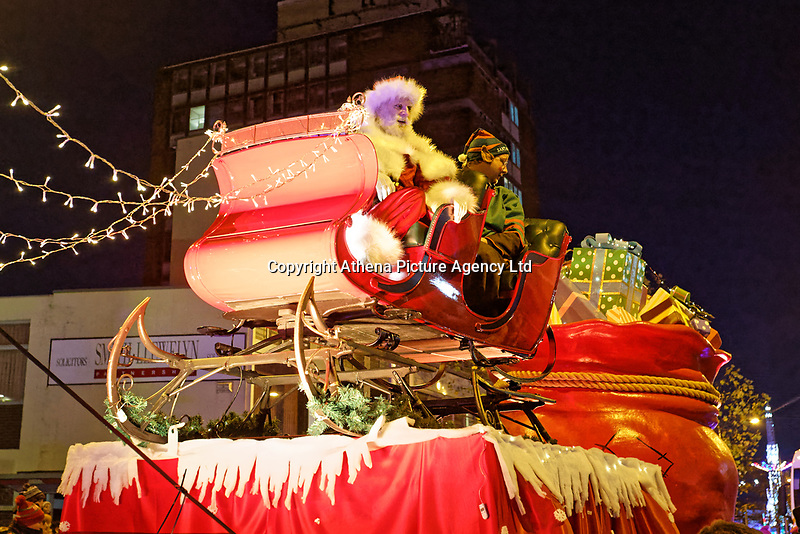 """Pictured: Father Christmas on one of the floats at the Christmas parade in Swansea, Wales, UK. Sunday 19 November 2018<br /> Re: Swansea Christmas parade attended by thousands has been branded a """"shambles"""" for having just three floats.<br /> The annual festive event in south Wales, which took place on Sunday, promised """"dynamic dance-troupes"""" as well as """"spectacular shows and stages"""".<br /> But the parade was scaled down, leading to a barrage of criticism on social media because of roadworks in the city centre. <br /> The leader of Swansea Council, Rob Stewart apologised on Facebook and said the parade was not """"good enough"""".<br /> Parents took on social media to voice their anger, calling the event """"a load of rubbish"""" and claiming there was nothing for young children apart from """"a loud music float with Santa on""""."""