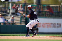 Detroit Tigers shortstop Willi Castro (49) prepares to throw to first base during a Grapefruit League Spring Training game against the Atlanta Braves on March 2, 2019 at Publix Field at Joker Marchant Stadium in Lakeland, Florida.  Tigers defeated the Braves 7-4.  (Mike Janes/Four Seam Images)