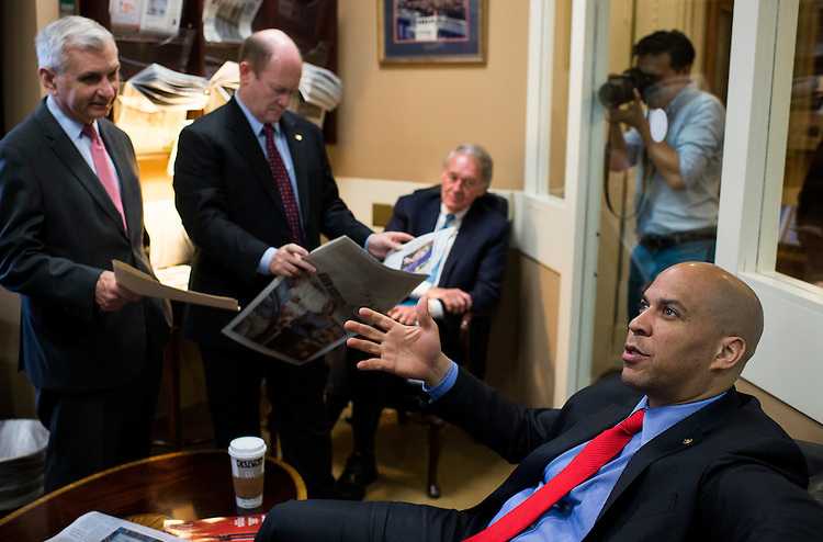 UNITED STATES - MAY 21: From left, Sen. Jack Reed, D-R.I., Sen. Chris Coons, D-Del., Sen. Edward Markey, D-Mass., and Sen. Cory Booker, D-N.J., talk before holding their news conference on Amtrak funding on Thursday, May 21, 2015. (Photo By Bill Clark/CQ Roll Call)